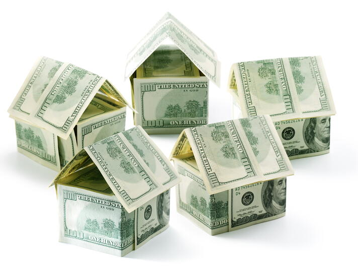 Dollar houses isolated over white