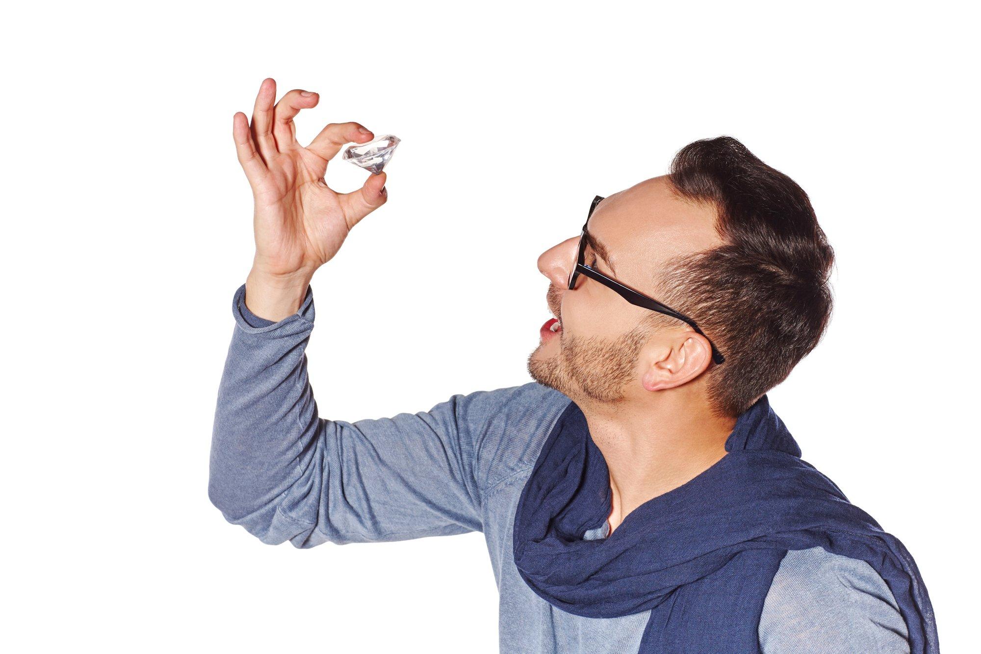 Man examining big diamond