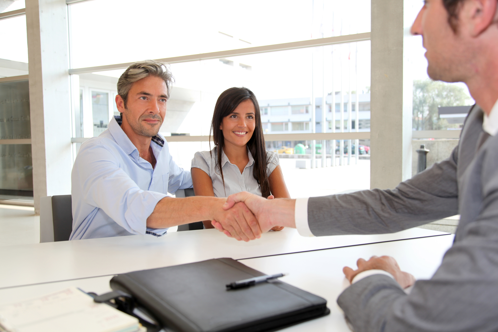 Man giving handshake to real-estate-agent