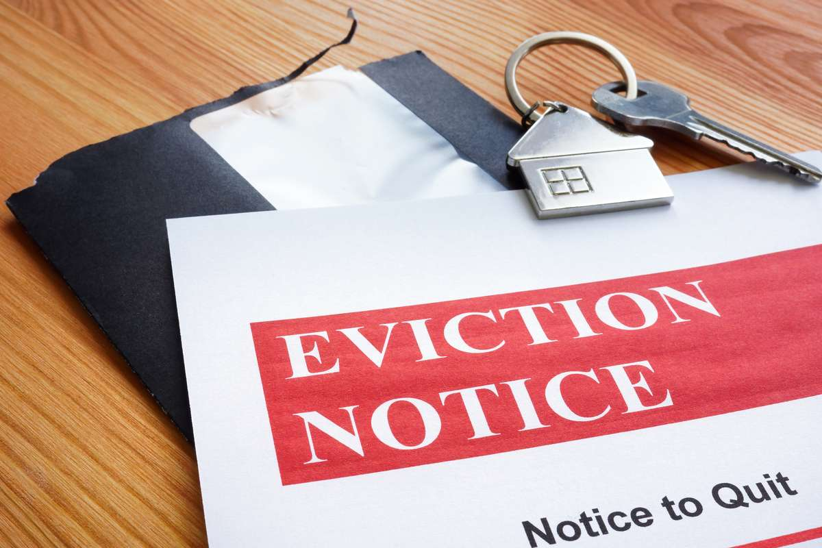Open envelope and eviction notice to quit papers. (R) (S)